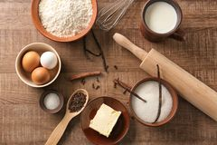 Composition with some products for cooking vanilla cake. On wooden background stock images