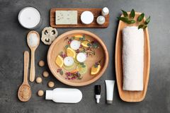 Composition with spa accessories and flowers. On grey background Royalty Free Stock Photography