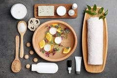 Composition with spa accessories and flowers. On grey background Stock Images