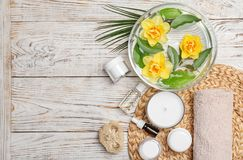Composition with spa accessories and flowers. On wooden background Royalty Free Stock Image