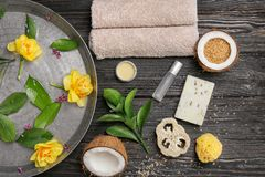 Composition with spa accessories and flowers. On wooden background Royalty Free Stock Photo