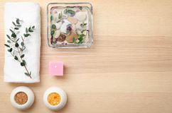 Composition with spa accessories and flowers. On wooden background Royalty Free Stock Photography