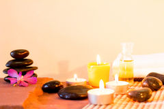 Composition of spa treatment with aromatic candles,orchid flower. Royalty Free Stock Photos