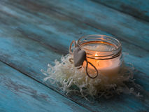 Composition of spa treatment candle on wooden background. Copy space Royalty Free Stock Photo