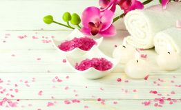 Composition of spa treatment. On white background. Pink massage sea salt and orchids. Close up.top view stock photos