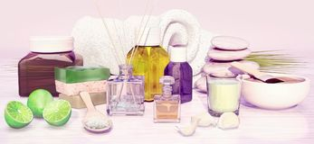 Composition of spa treatment, lime, handmade soap, aromatic oil, Royalty Free Stock Photo