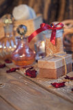 Composition of spa treatment. Natural handmade soap and sea salt Stock Photos