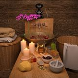 Composition of spa treatment with orchid on dark wooden background. Spa and wellness setting with natural soap, candles and towel stock photography