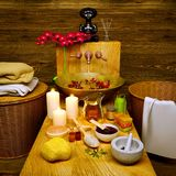 Composition of spa treatment with orchid on wooden background. Royalty Free Stock Photography