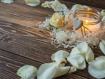 Composition of spa treatment rose, candle on wooden background. Copy space. Stock Photos