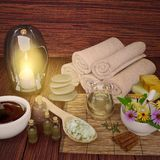 Composition of spa wellness products on dark wooden background. Stock Photo