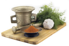 Composition of spices, mix dry hot peppers, dill, garlic, vintage spice grinder isolated on white background Royalty Free Stock Photography
