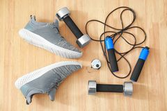 Composition with sport shoes. On wooden background Stock Images