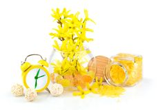 Composition from spring yellow flowers, aroma salt and alarm clo Stock Images