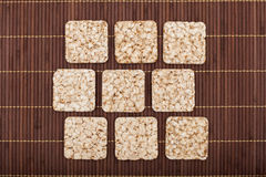 Composition of square nine crunchy rye crispbreads Royalty Free Stock Photo