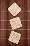 Composition of square three crunchy rye crispbreads royalty free stock photo