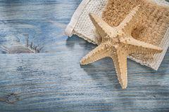 Composition of starfish wisp bast on wooden board healthcare concept Royalty Free Stock Photography