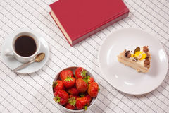 Composition with starwberry, book, cake and cup of coffee Royalty Free Stock Images