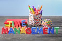 Composition with stationery and phrase Time management composed from letters on wooden table royalty free stock photography