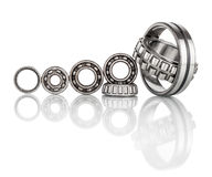 Composition of steel ball roller bearings in closeup isolated on white Stock Photo