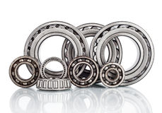Composition of steel ball roller bearings in closeup isolated on white