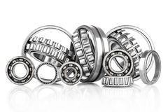 Composition of steel ball roller bearings in closeup isolated on white Stock Images