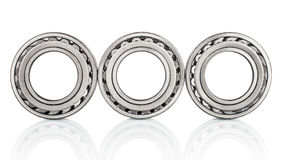 Composition of steel ball roller bearings in closeup  on white Royalty Free Stock Photo