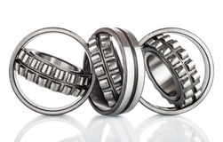 Composition of steel ball roller bearings in closeup  on white Royalty Free Stock Photography