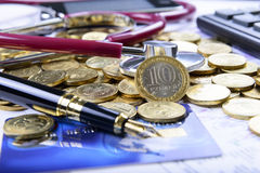 Composition of stethoscope on the money Stock Image