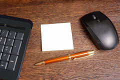 Composition with sticker,  mouse, pen and keyboard Stock Images