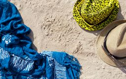 Composition still life on the beach two hats glasses pareo towel lie on the yellow sand summer day rest stock photography