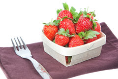 Composition of strawberries in a basket and a fork Royalty Free Stock Image