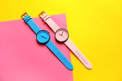Composition with stylish wrist watches on color background, flat lay. Fashion accessory stock photography