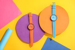 Composition with stylish wrist watches on color background, flat lay. Fashion accessory royalty free stock photo