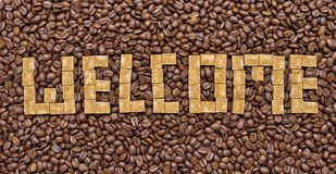 Composition of sugar and coffee beans in the form of welcome Stock Photos