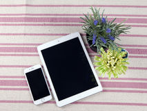 The composition of the tablets on a rustic rug with flowers Stock Photography