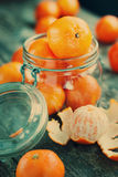 Composition with Tangerines in a Jar. Toned Stock Image