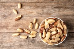 Composition with tasty Brazil nuts on wooden background. Top view royalty free stock photo