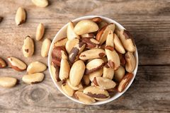 Composition with tasty Brazil nuts on wooden background. Top view stock photos