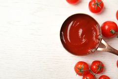 Composition with tasty homemade tomato sauce and space for text on white wooden background. Top view royalty free stock images