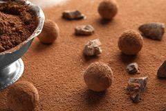 Composition with tasty raw chocolate truffles. On cocoa powder stock photo