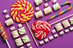 Composition with tasty sweets on color background. Closeup Royalty Free Stock Photos