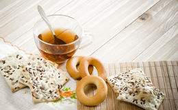 The composition of the tea beverage in a large bowl and some sweets Royalty Free Stock Photography