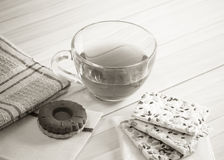 The composition of the tea beverage in a large bowl and some sweets Stock Photo