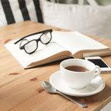 Composition with tea cup and book. Royalty Free Stock Photography