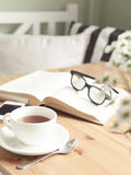 Composition with tea cup and book. Royalty Free Stock Images