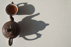 Composition with tea in cup and teapot  on table Royalty Free Stock Photo
