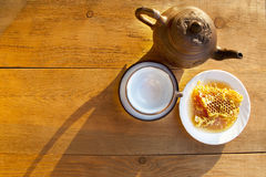 Composition with tea in cup and teapot  on table Stock Photos