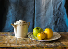 Composition of a teapot and a plate with apples Royalty Free Stock Image