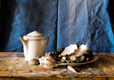 Composition of a teapot and a plate filled with clams Royalty Free Stock Photo